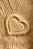 Dimensión de una variable del corazón en la arena Fotografía de archivo libre de regalías