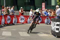 Dimension Data Team competitor at Giro 2017, Milan. MILAN, ITALY - MAY 28: last stage of Giro 2017, Dimension Data Team competitor in black suit tackles a bend royalty free stock photos