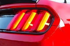 Dimensionella lyktor av den röda moderna sportbilen Fotografering för Bildbyråer
