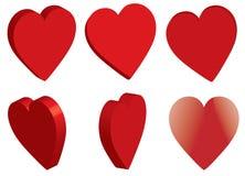 dimensiones de una variable rojas de los corazones 3d Foto de archivo libre de regalías