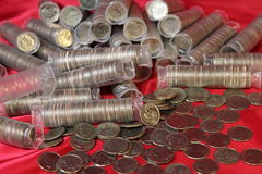 Dimes on red cloth Royalty Free Stock Image