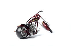 Diminished copy of motor cycle (view from behind) Royalty Free Stock Image