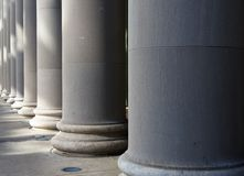 Diminishing Columns. Row of large stone or concrete Diminishing Columns of a building royalty free stock photo