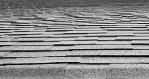 Diminishing composition roof. Black and white image of a composition roof diminishing to soft focus at the top of the image Stock Image