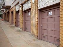 Diminishing Garage Doors. Row of ocher garage doors diminishing up a hill in San Francisco royalty free stock images