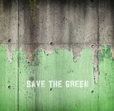 Diminishing green. Ecological concept image. Diminishing green. Peeling green paint on concrete wall. Ecological concept image stock photography