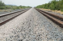 Diminishing Lines Railroad Tracks and Gravel. Two parallel Railroad Track with Gravel between them forming diminishing lines stock photo