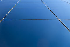 Diminishing Curtain Wall. Diminishing perpective of an office building's glass curtain wall reflecting the clear blue sky Royalty Free Stock Photo