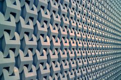 Diminishing perspective of a building 3D decorative pattern metallic grey outer wall. Texture background abstract architecture art backdrop banner blue bright royalty free stock images