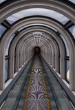 Diminishing perspective in a futuristic escalator tube. Where does this tunnel bring us to stock images