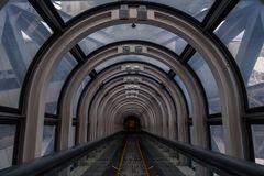 Diminishing perspective in a futuristic escalator tube. Where does this tunnel bring us to stock photos