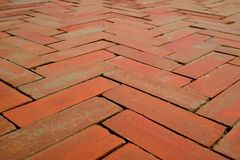 Diminishing Perspective of Geometry Pattern of Terracotta Brick Pathway at Ayutthaya Historical Park, Thailand. Texture Background royalty free stock photos