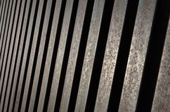 Diminishing perspective of steel bars. Repetition pattern of rusty steel  bars. Diminishing perspective of geometric pattern stock photography