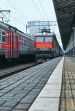 Diminishing perspective view of railway station with stone platform. In Moscow royalty free stock photography