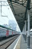 Diminishing perspective view of railway station with stone platform. In Moscow royalty free stock image
