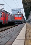 Diminishing perspective view of railway station with stone platform. In Moscow royalty free stock images