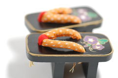 Diminuto - sandálias japonesas Imagens de Stock