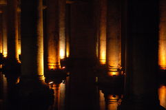 Dimly-lit column path. In the underground cistern in Istanbul royalty free stock images