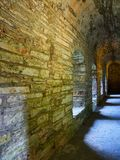 Dimly lit corridor of an old structure several centuries old stock photos