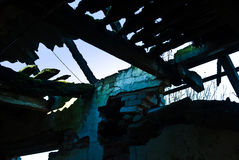 Dimly-lit dilapidated barn. Dimly-lit dilapidated, decaying barn from Soviet-era Royalty Free Stock Photography