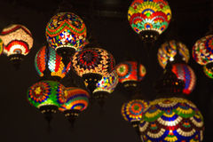 DImly lit exotic lamps for decoration in old home with multicolo Royalty Free Stock Images