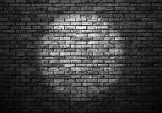 Dimly lit old brick wall royalty free stock photo