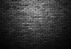 Dimly lit old brick wall Stock Photo