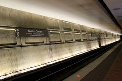 Dimly lit section of tracks beneath the Metro Center,the central hub station, Washington,DC, 2015. Dimly lit section of tracks in the Metro center,where people stock photos