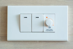 Dimmer switch and light switch Stock Photos
