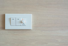 Dimmer switch and light switch Stock Photo