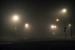 Dimmiga dimmiga gataljus Arkivfoto