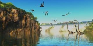 Dimorphodon and Omeisaurus Dinosaurs. Omeisaurus herbivorous sauropod dinosaurs wade through a river below a waterfall as Dimorphodon flying reptiles fly Stock Photo