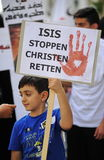 Dimostrazione contro le persecuzioni e le atrocità nell'Irak fotografia stock