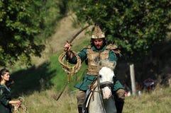 Dimostrazione equestre in costumi tradizionali Fotografia Stock