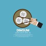 Dimsum avec des baguettes Photographie stock