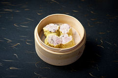 Dimsum in bamboo container Royalty Free Stock Image