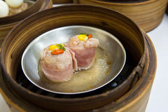 Dimsum in bamboo container closed up. Chinese cuisine Dimsum in bamboo container closed up Stock Photos