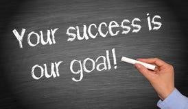 Din framgång är vårt mål arkivfoto