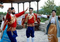Dinamic folk dance. Beautiful dancers and singers at the nice folk style evening meal in Montenegro royalty free stock image