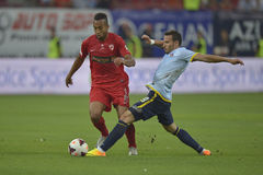 Dinamo Bucharest - Steaua Bucharest, Romanian football derby. Steaua's Adrian Cristea (R) and Dinamo's Joël Thomas (L) pictured in action during the game Dinamo Stock Photo