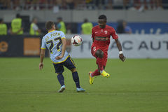 Dinamo Bucharest - Steaua Bucharest, Romanian football derby. Steaua's Adrian Popa (L) and Dinamo's  Collins Fai (R) pictured in action during the game Dinamo Stock Photography