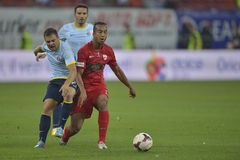 Dinamo Bucharest - Steaua Bucharest, Romanian football derby. Steaua's Adrian Popa (L) and Dinamo's  Joël Thomas (R) pictured in action during the game Dinamo Royalty Free Stock Photo