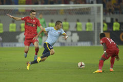 Dinamo Bucharest - Steaua Bucharest, Romanian football derby. Steaua's Daniel Gheorghievski (centre) and Dinamo's Dorin Rotariu (R) pictured in action during the Stock Photography