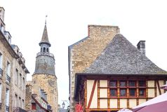 Landscapes and architectures of Brittany. Dinan, France - August 8, 2017: The ancient houses of the country center with the medieval Clock Tower in the Stock Photography