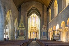 Landscapes and architectures of Brittany. Dinan, France - August 8, 2017: View of the nave of the Saint Sauveur basilica Royalty Free Stock Photography