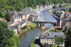 Dinan on the Rance, Brittany, France. Medieval city of Dinan and his gothic bridge on the Rance, Brittany, France Stock Photo