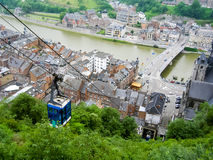 Dinant, Belgium. Touristic city of Dinant in the Ardennes region of Belgium, with the cable car leading up to the citadel Royalty Free Stock Images