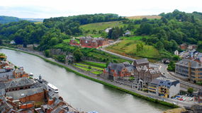 Dinant and the River Meuse, Belgium. Old city and nature coming together in a wide-open panoramic view.  The River Meuse valley with the town of Dinant below Royalty Free Stock Photo