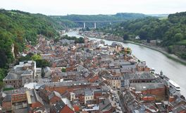 Dinant and the River Meuse, Belgium. Old city and nature coming together in a wide-open panoramic view.  The River Meuse valley with the town of Dinant below Stock Photo