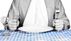 Diner awaiting food service. A diner waiting in anticipation of food Stock Photography